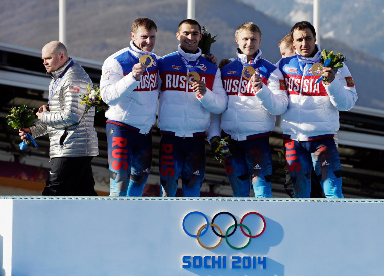 Image: The Russian team poses with their medals after they won the gold.