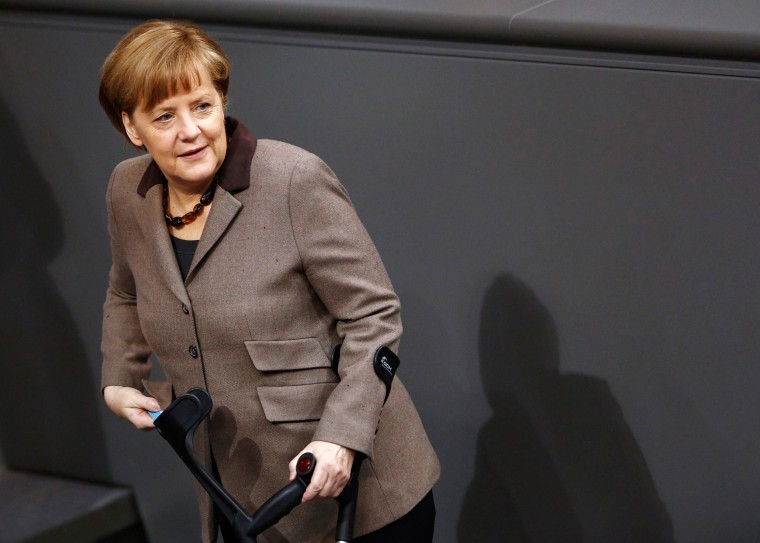 Image: German Chancellor Angela Merkel arrives to cast her votes after debate about deputy allowances and graft at lower house of parliament, the Bundestag, in Berlin