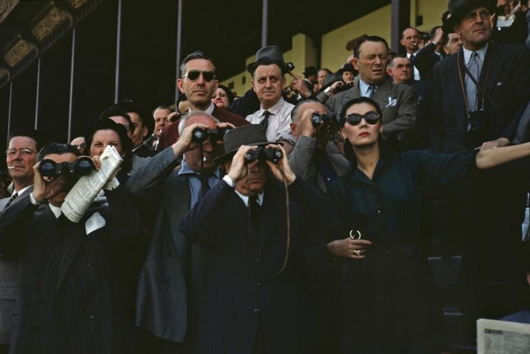 Spectators use binoculars at the Longchamp Racecourse in Paris circa 1952.