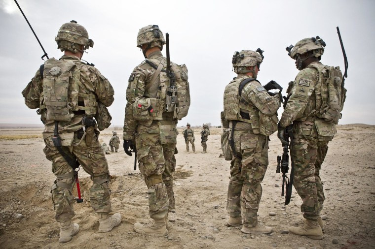 Members of the U.S. Army survey the horizon after an improvised explosive device (IED) attack during a patrol outside Command Outpost AJK (short for Azim-Jan-Kariz, a near-by village) in Maiwand District, Kandahar Province, Afghanistan, January 28, 2013. No one was killed in the attack.   REUTERS/Andrew Burton (AFGHANISTAN - Tags: POLITICS MILITARY CIVIL UNREST) - RTR3D399