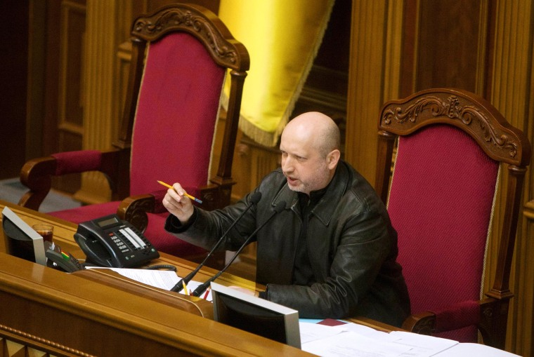 Image: Newly elected speaker of parliament Oleksander Turchynov attends a session of the Ukrainian parliament in Kiev