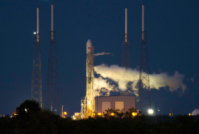 Image: The unmanned Space Exploration Technologies' Falcon 9 rocket is seen before liftoff at Cape Canaveral, Florida
