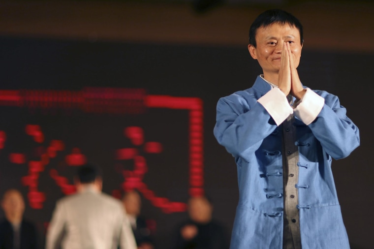 Jack Ma, the chairman of China's largest e-commerce firm Alibaba Group, gestures before giving a performance of Tai Chi at the Annual Summit of Green Companies 2013