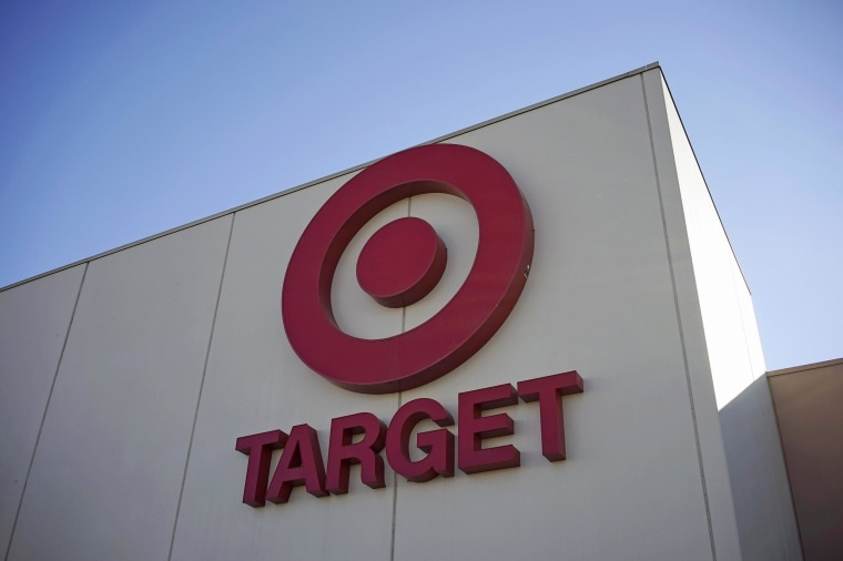 Target says the massive data breach over the holidays helped push its profit down 46 percent.