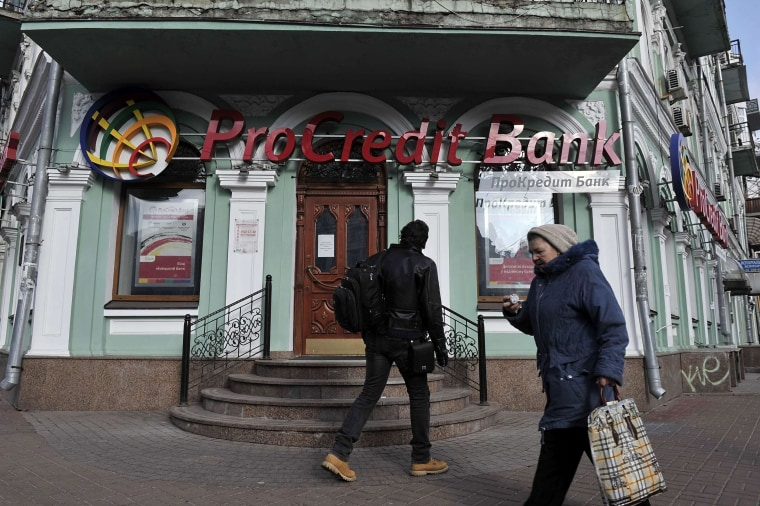 Fears of a run on banks rose in Ukraine as central bank reserves sank.
