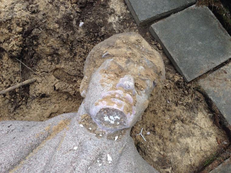 A felled statue of Lenin.