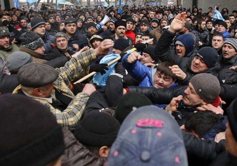 Image: Pro-Russian protesters, right, clash with Crimean Tatars