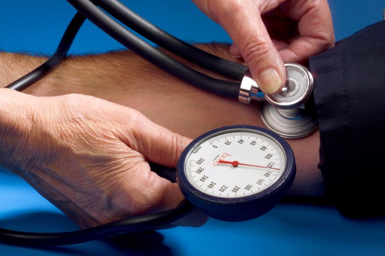 A patient gets his blood pressure measured with a sphygmomanometer and a stethoscope in Iserlohn, Germany on Sept. 17, 2005.