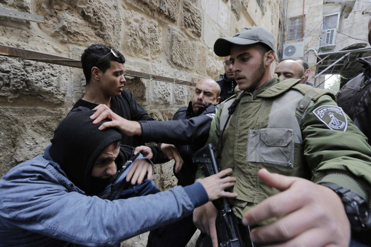 Image: Israeli police and border police officers scuffle with a Palestinian in Jerusalem's Old City