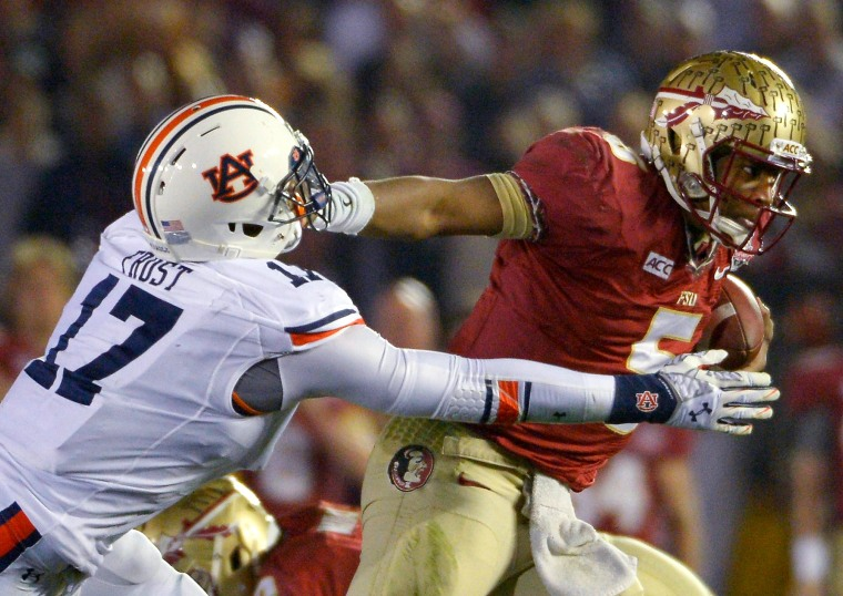 Florida State's Jameis Winston breaks free during the NCAA BCS National Championship college game Jan. 6 in Pasadena, Calif. Some sports lawyers argue college athletes like Winston, who generate millions of dollars for their schools, should be compensated for the hours they devote to their teams.