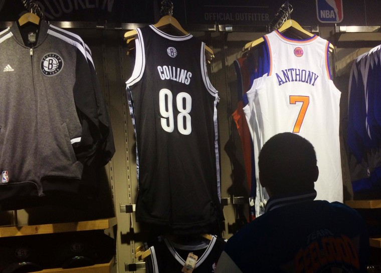 Image: Jason Collins' new Brooklyn Nets jersey is on sale at a store.