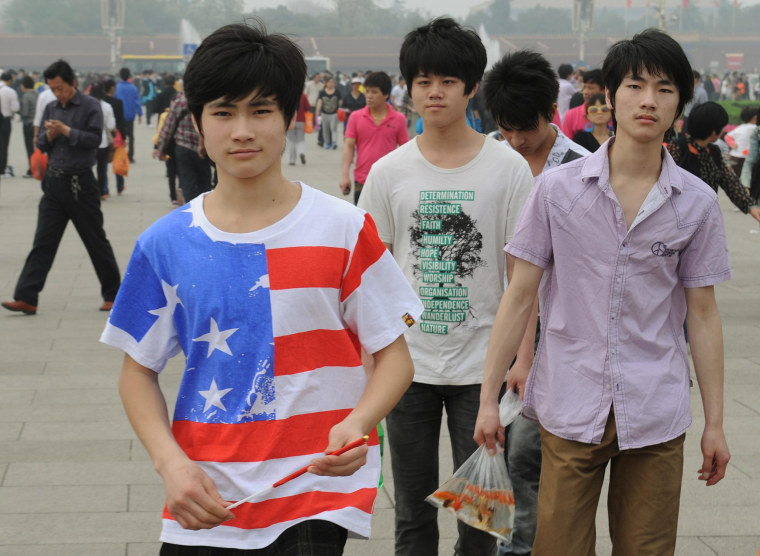 A Chinese youth wearing an American flag
