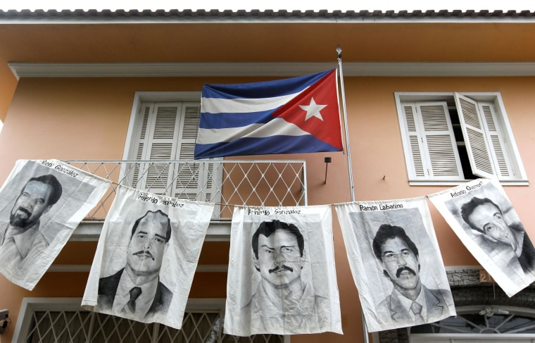 Image: Posters with portraits of five Cuban intelligence agents jailed in the United States - Rene Gonzalez Sehwerert, Gerardo Hernandez Nordelo, Fernando Gonzalez Llort (C), Ramon Labanino Salazar and Antonio Guerrero Rodriguez