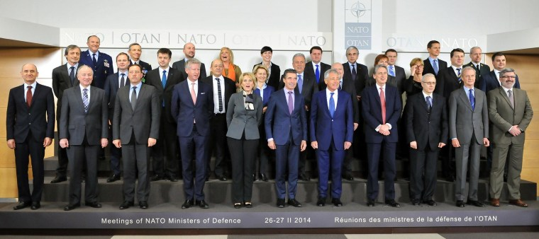 Image: NATO Secretary General  Anders Fogh Rasmussen (C) and NATO defense ministers