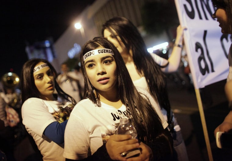 Image: Young women wear headbands featuring the name of Chapo Guzman during a march in Culiacan