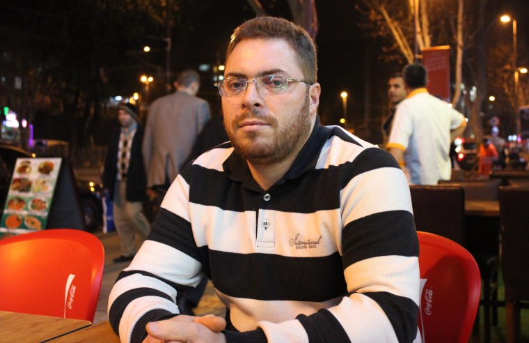 Image: Abdullah Binnishy, a baker from the Syrian city of Aleppo poses for a photo in Istanbul.