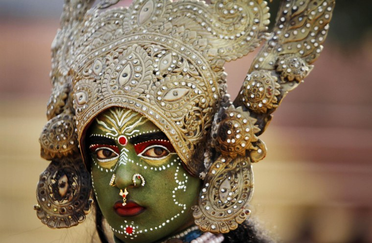 A women dressed as Hindu Goddess Kali participates in a procession on the eve of Shivratri festival, in Jammu, India on Feb. 26. Shivratri, a festival dedicated to the worship of Hindu God Shiva, will be marked across the country Thursday.