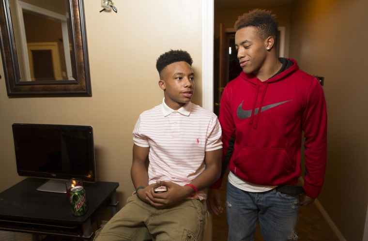 Image: Dontadrian Bruce, 15, left and his older brother  Dontavis Bruce, 17.