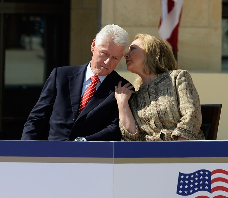 Image: ormer first lady and former Secretary of State Hillary Rodham Clinton speaks with her husband former president Bill Clinton
