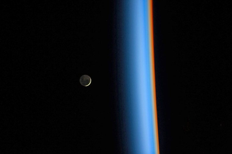 Image: Crescent Moon rising and Earth's atmosphere