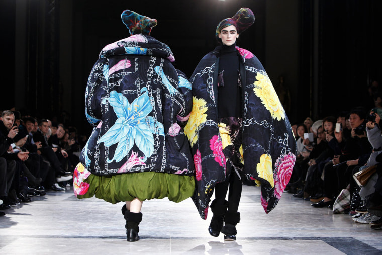 Image: Models wear creations for Yamamoto's ready-to-wear fall/winter 2014-2015 fashion collection