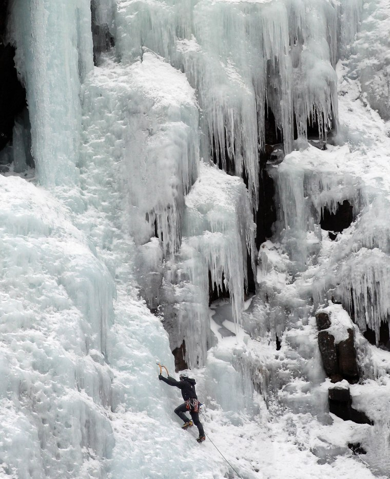 Image: An ice climber makes his way up Frankenstein Cliff in Hart's Location, N.H.