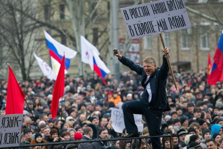 Image: Pro-Russian protesters with Russian flags take part in a rally in central Donetsk