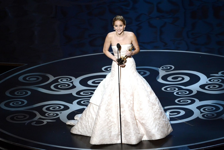 """HOLLYWOOD, CA - FEBRUARY 24:  Actress Jennifer Lawrence accepts the Best Actress award for """"Silver Linings Playbook"""" during the Oscars held at the Dolby Theatre on February 24, 2013 in Hollywood, California.  (Photo by Kevin Winter/Getty Images)"""