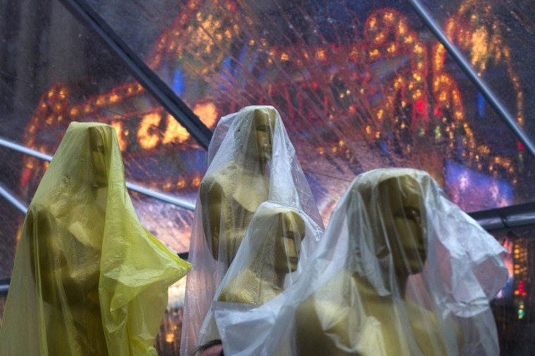 Image: Covered Oscars statues rest under a tent, to guard against rain, along the red carpet ahead of the 86th Academy Awards in Hollywood, Calif.