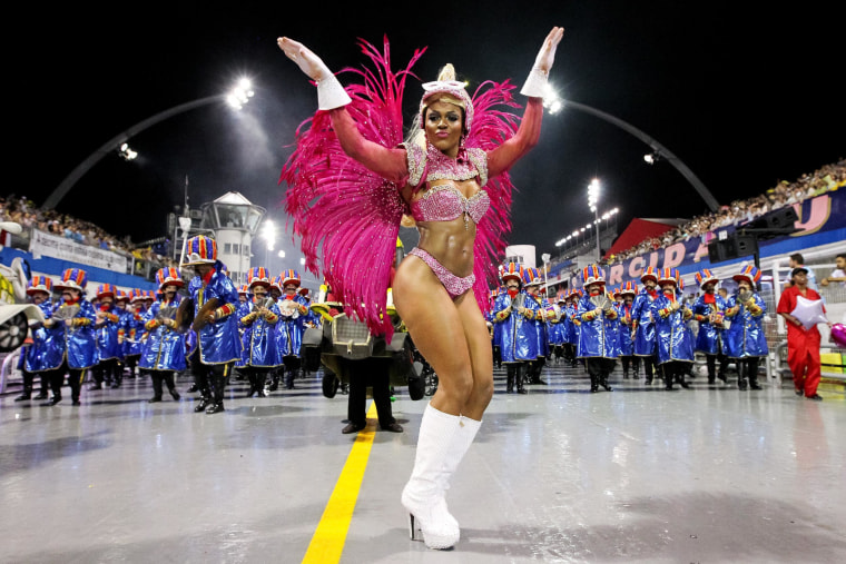 Image: Members of the Dragoes da Real samba school perform during the first night of the Sao Paulo's Carnival parade