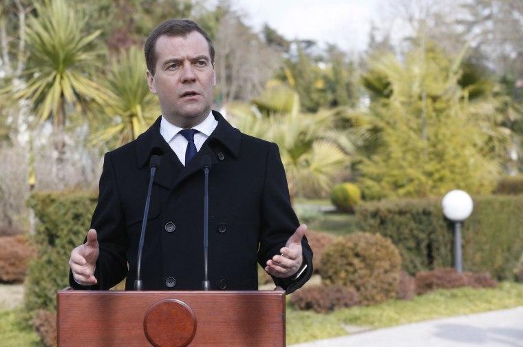 Russian Prime Minister Dmitry Medvedev speaks to journalists in Sochi February 24.