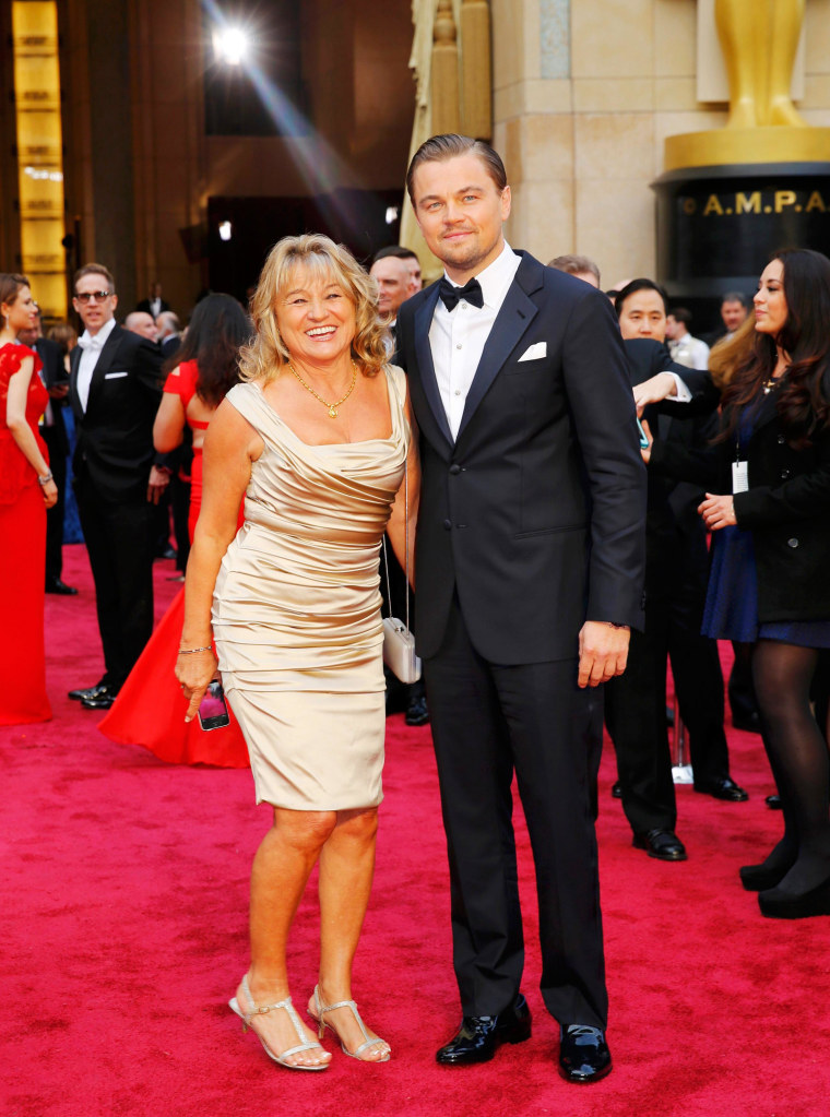 Image: Leonardo DiCaprio and his mother Irmelin DiCaprio arrive on the red carpet at the 86th Academy Awards in Hollywood