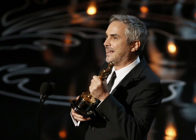 "Image: Alfonso Cuaron accepts the Oscar for best director for ""Gravity"" at the 86th Academy Awards in Hollywood"