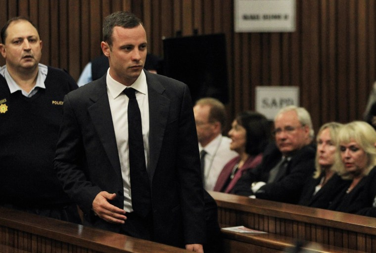 Image: Oscar Pistorius arrives for his trial at the high court in Pretoria, South Africa.