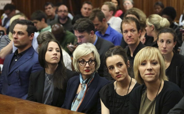 Image: The family members of Pistorius sit in court ahead of his trial in Pretoria