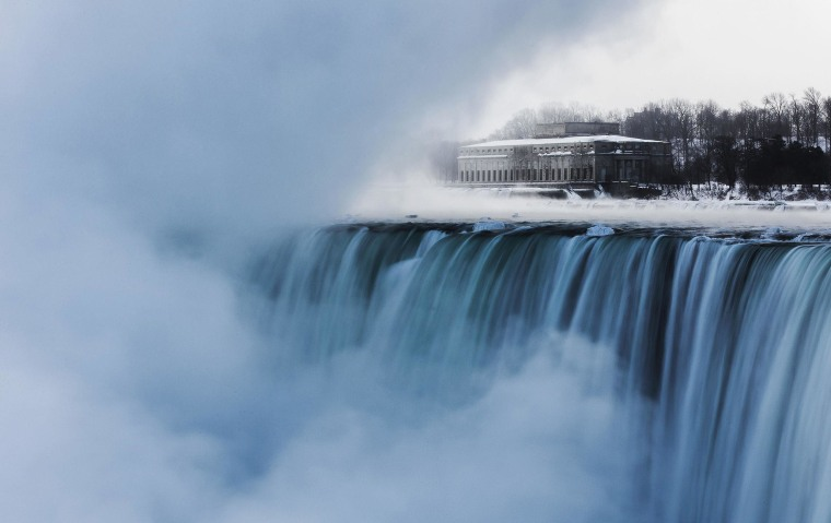 Image: An old hydro building is seen behind Niagara Falls during sub freezing  temperatures in Niagara Falls