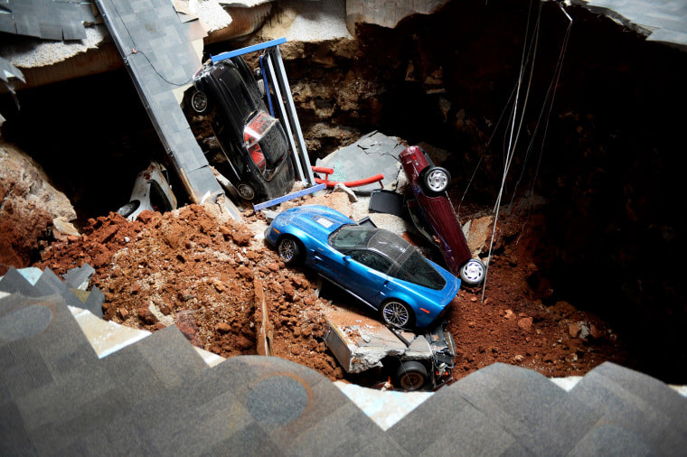 A view of a sinkhole that opened up in the Skydome showroom, Wednesday, Feb. 12, 2014, at the National Corvette Museum in Bowling Green, Ky. Eight display cars were swallowed by the hole. (AP Photo/Michael Noble Jr)