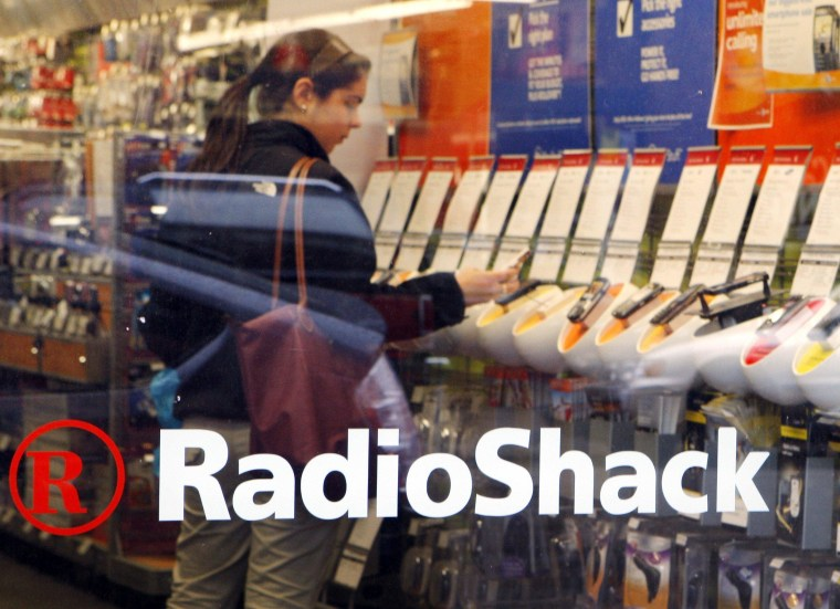 Image: A shopper looks over the mobile phones displayed at a RadioShack store in Cambridge