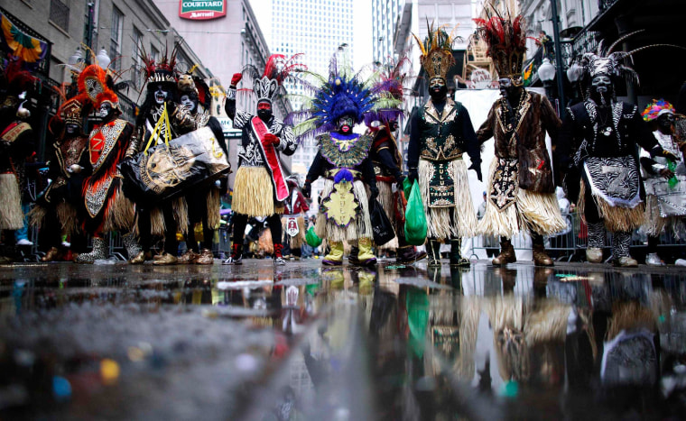 Image: Members of the Krewe of Zulu parade down St. Charles Avenue on Mardi Gras Day in New Orleans