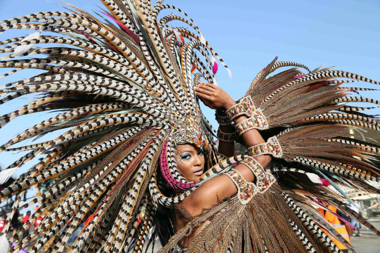Image: Trinidadian model Soowan Bramble performs in an individual mas Carnival costume in Port-of-Spain