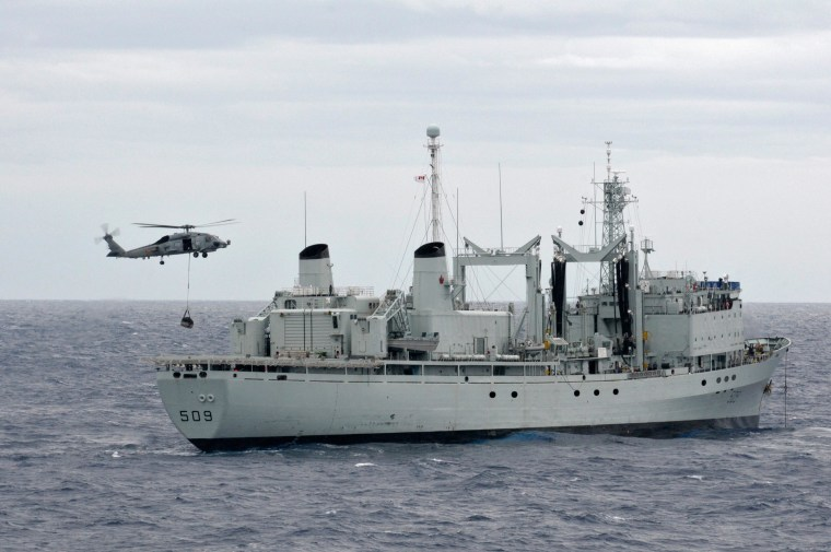 Image: An SH-60B Sea Hawk helicopter prepares to unload materials aboard the Royal Canadian Navy auxiliary oil replenishment ship HMCS Protecteur (AOR 509) on March 1, 2014.