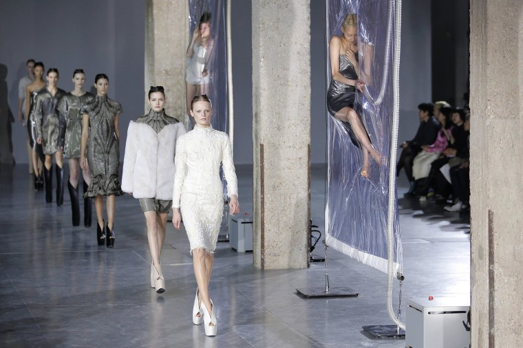 Image: Models present creations by designer Iris van Herpen as part of her Fall/Winter 2014-2015 women's ready-to-wear collection during Paris Fashion Week