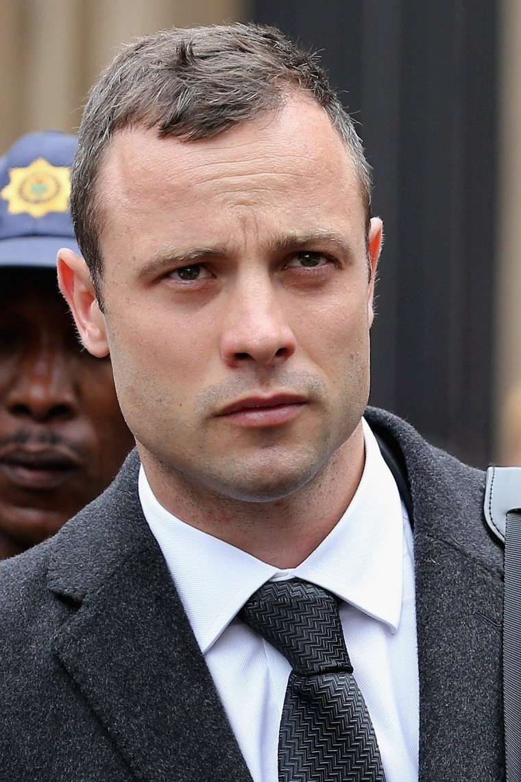 Oscar Pistorius leaves North Gauteng High Court in Pretoria, South Africa, during a break in his murder trial on Wednesday.