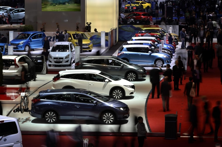People attend the press day of the Geneva Motor Show in Geneva, on March 5, 2014.
