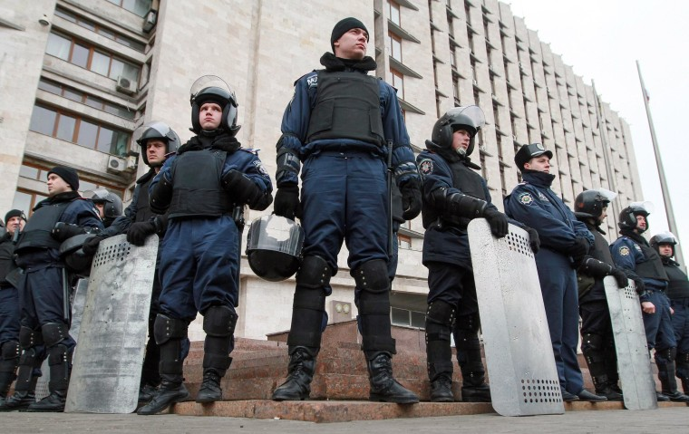 Ukrainian policemen stand guard at the Regional administration building in Donetsk on March 5.