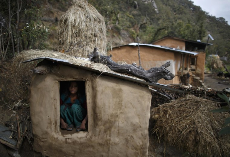 Image: Uttara Saud sits inside a Chaupadi shed in the hills of Legudsen village in Achham District in western Nepal