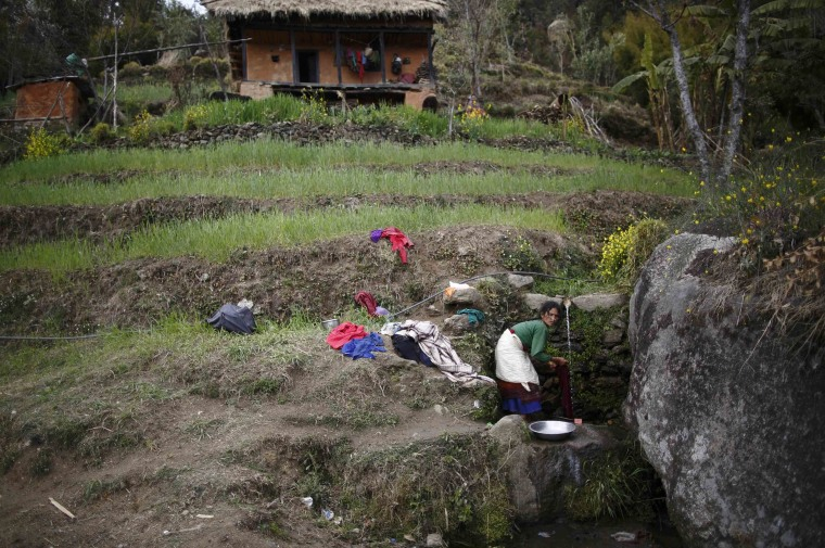 Image: Suntali Devi Saud, who practices Chaupadi, washes her clothes in Achham District in western Nepal