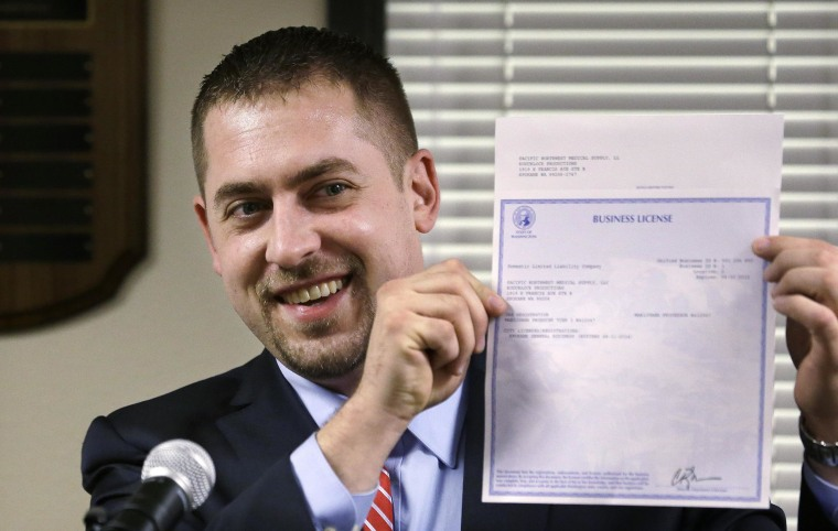 Image: Sean Green received the first legal marijuana license in Washington state.