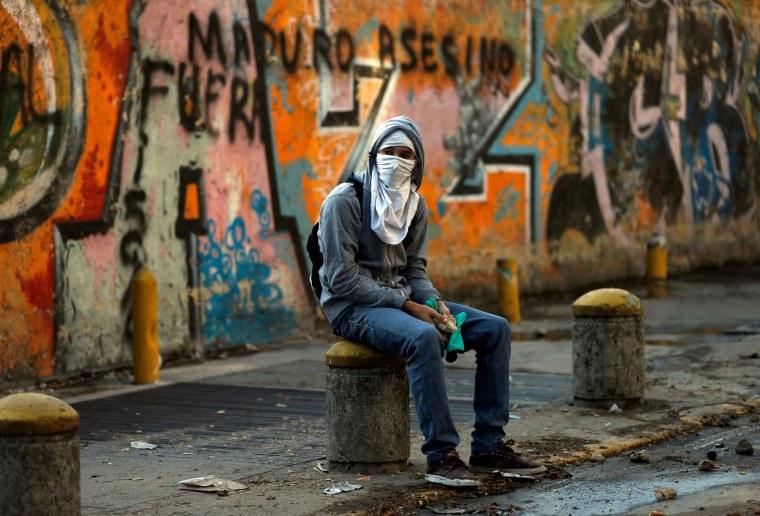 Image: A demonstrator takes a break in Caracas, Venezuela
