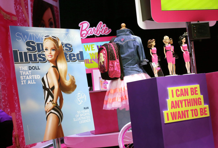 A mock-up cover of Barbie on a Sports Illustrated Swimsuit issue is displayed at the Mattel booth on Feb. 14 at the American International Toy Fair in New York.